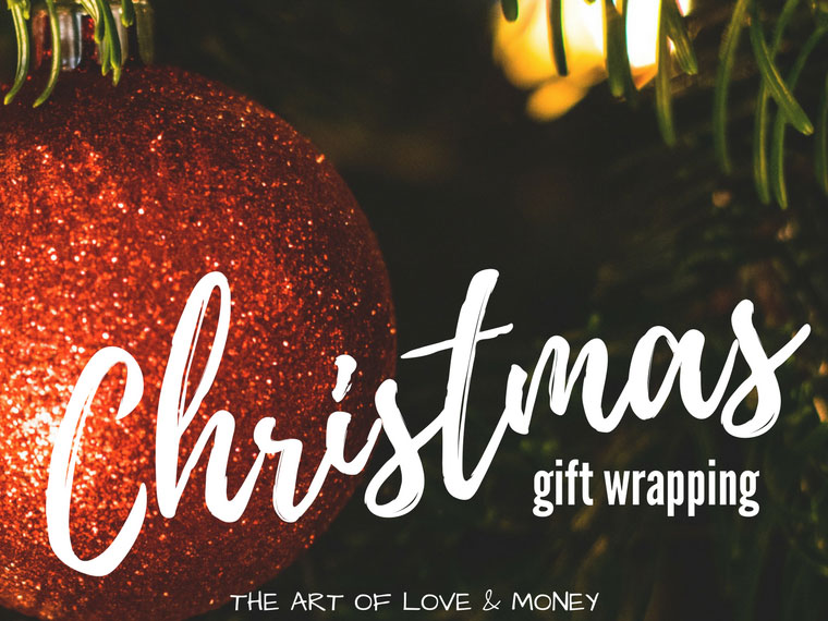 The Art of Love & Money Christmas Gift Wrapping red glittery ornament on tree