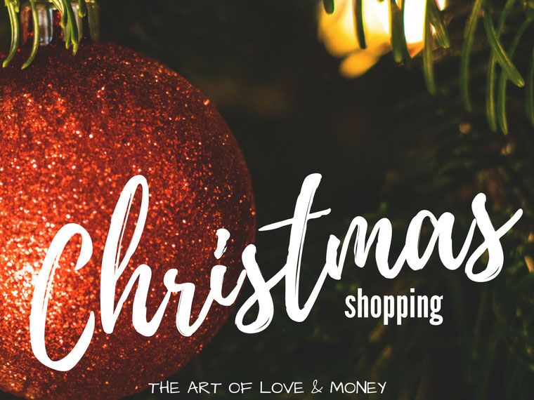 The Art of Love & Money Christmas Shopping red glittery ornament on tree